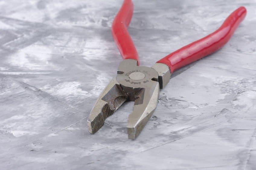 Pliers with plastisol dip coating